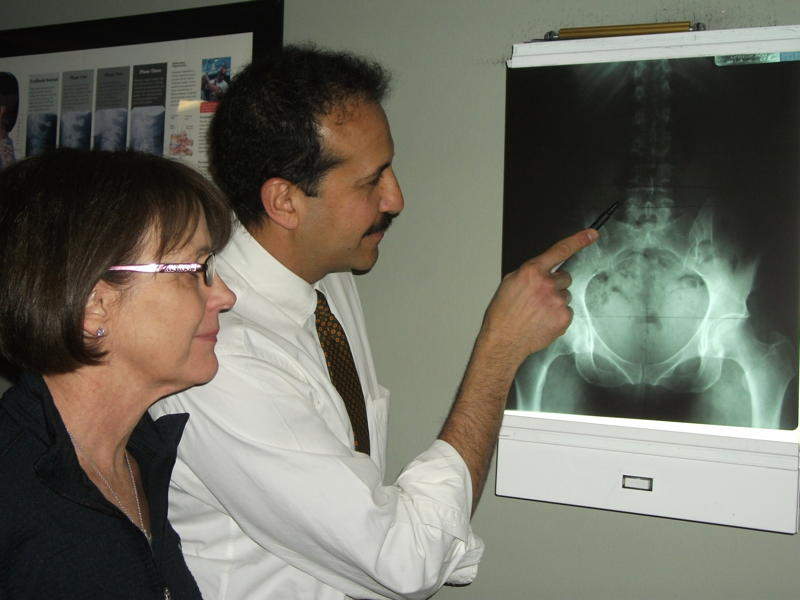 chiropractor Dr. Azab and patient with xrays